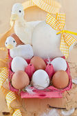 Box of eggs and easter decorations — Stock Photo