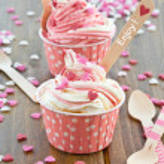 Frozen Yogurt with sugar hearts — Stock Photo