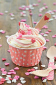 Frozen Yogurt with sugar hearts — Stock Photo