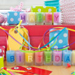 Happy Birthday written on candles — Stock Photo