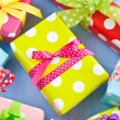 Stock Photo: Colorful gift boxes wrapped in dotted paper