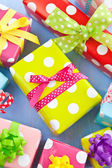 Colorful gift boxes wrapped in dotted paper — Stock Photo