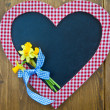Stock Photo: Heart-shaped chalkboard and fresh daffodils