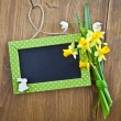 Stock Photo: Little chalkboard and spring flowers