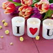 Stock Photo: Fresh tulips and candles