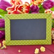 Stock Photo: Fresh tulips and little chalkboard