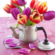 Stock Photo: Fresh tulips on red