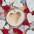 Stock Photo: Wooden background with hearts