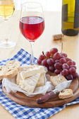 Wine, cheese and bread — Stock Photo