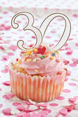 Little cupcake with pink frosting — Stock Photo