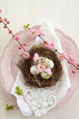 Little easter nest on pink plate — Stok fotoğraf