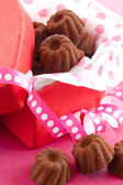 Little chocolates in red box — Stock Photo
