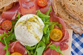 Mozzarella, smoked ham and fresh tomatoes — Stock Photo