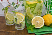 Lemonade with cucumber and lemons — Stock Photo