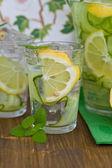 Lemonade with cucumber and lemons — Stock Photo