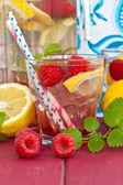 Homemade lemonade with raspberries — Stock Photo