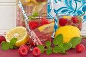 Homemade lemonade with raspberries — Stock Photo