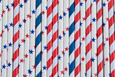 Colorful stars and stripes straws — Stock Photo
