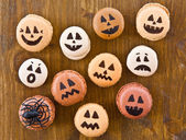 Macaroons with scary faces — Stock Photo