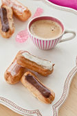 Coffee and little eclairs — Foto de Stock