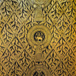 Golden pattern on temple door of Thailand. It is religious symbol. — Foto de stock #27286731