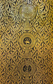 Golden pattern on the temple door of Thailand. It is a religious symbol. — Stock Photo