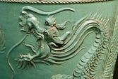 Old Chinese urn with a dragon pattern — Stock Photo