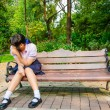 High-Schoolgirl crying alone on the bench — Stock Photo