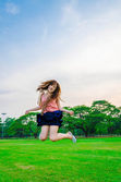 Asian girl jumping with joy — Stock Photo