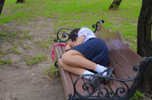 Thai Schoolgirl sleeping on the bench — Stock Photo