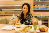 An asian (Thai) girl ready to eat her meal. — Stockfoto