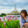 Cute Thai girl is relaxing beside the river bank — Stock Photo