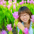Cute Thai girl is very happy with flowers — Stock Photo