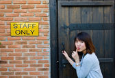 Cute Thai woman is sneaking the secret area — Stock Photo
