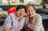 Family Portrait of an Asian elder mother and daughter hold together in home scenery — Stock Photo