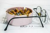 Ashtray and glasses on white blueprint backgroun — Stock Photo