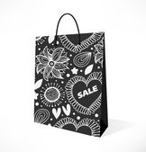 Isolated black and white pocket. Ornamental with flowers pattern paper-bag. Pack, package, parcel — Stock Vector