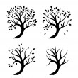 Silhouettes of trees — Vector de stock