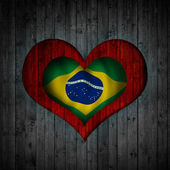 Heart and wood background Brazil flag — Stock Photo