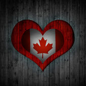 Heart and wood background canada flag — Stock Photo