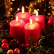 Close-up of four burning candles on advent wreath — Stock Photo