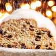 Christmas stollen and pouring sugar — Stock Photo