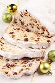 Christmas traditional stollen and ornaments — Stok fotoğraf