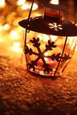 Lantern with snowflake with Christmas lights — Stock Photo
