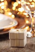 Close up of gift on holiday table setting — Stock Photo