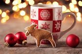Gingerbread cookie and Christmas decorations — Stock Photo