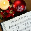 Stock Photo: Detail of songbook with christmas carols
