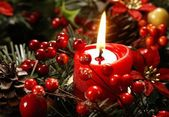 Red candle and christmas decorations — Stock Photo