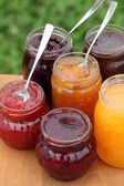 Glasses with different kinds of jam — Stock Photo