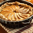 Stock Photo: Arrangement of home-made apple pie and apples.
